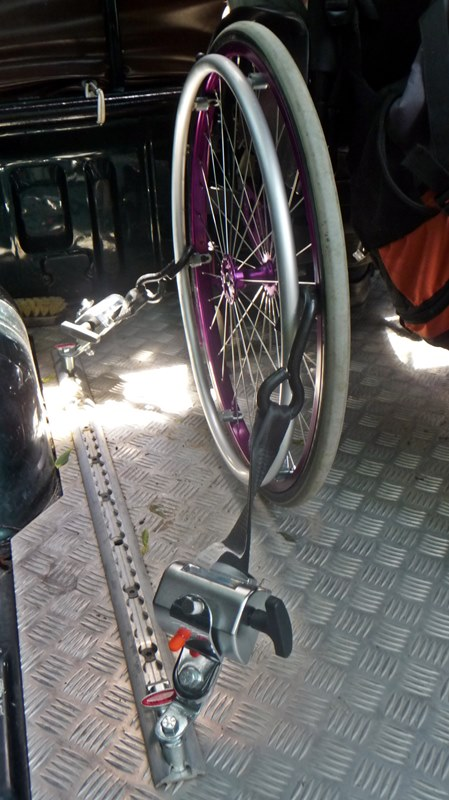 Stabilizing the wheelchair on the truck